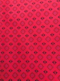 red shweshwe fabric with centre flower