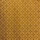 star cross design on mustard coloured shweshwe fabric