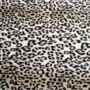 beige and white animal print fur