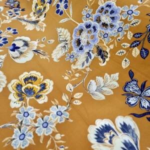 rust or blue coloured floral prints on viscose fabric