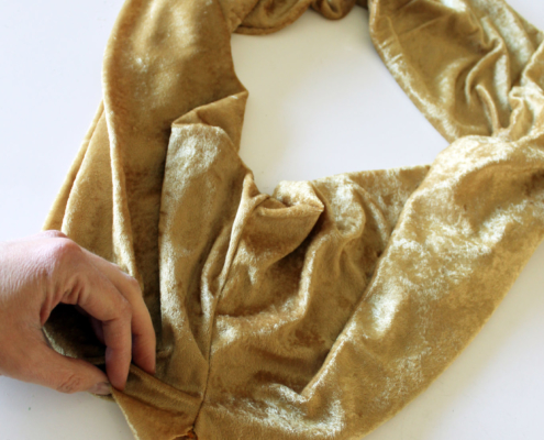 Sewing your infinity scarf together and leave a hole
